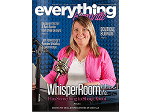 A female broadcaster smiling behind a microphone on the cover of Everything Knoxville magazine