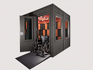 An 8'x8' WhisperRoom sound isolation booth with a wheelchair ramp and ADA package