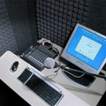 A computer monitor and other equipment inside of a WhisperRoom for product testing