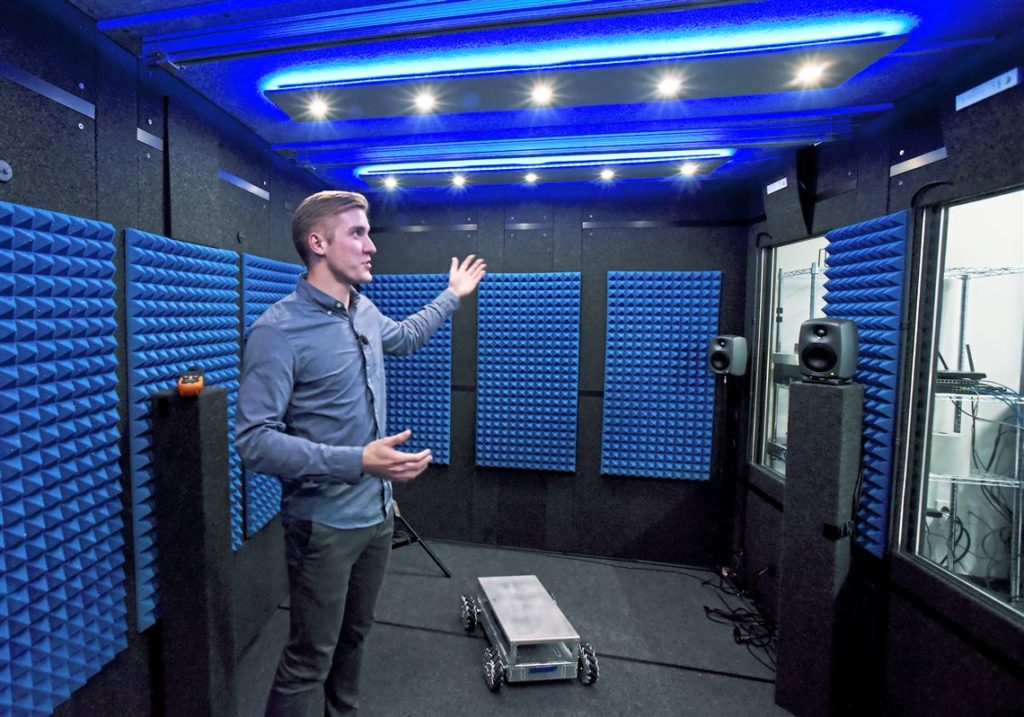 A Researcher From Bosch inside of his WhisperRoom Testing Booth