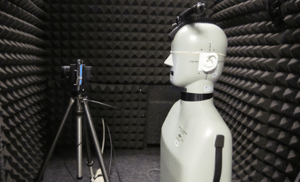 A manikin and camera set up inside of a WhisperRoom for product testing by Verizon Wireless