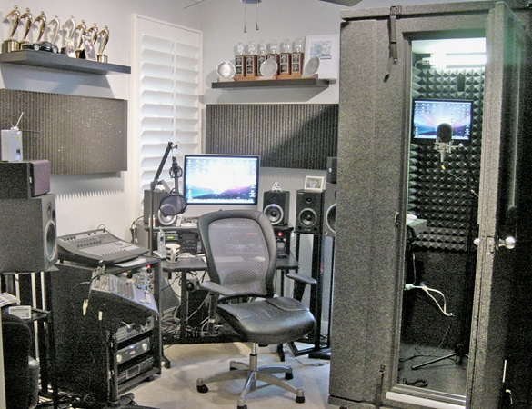 A home studio that is full of trophys, studio gear, and equipment to record voice-overs