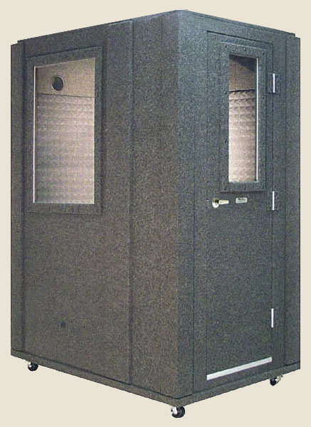 A 3.5'x5' WhisperRoom sound isolation booth with a tan background