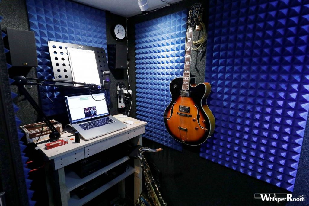 image of guitar and sax inside of a whisperroom booth