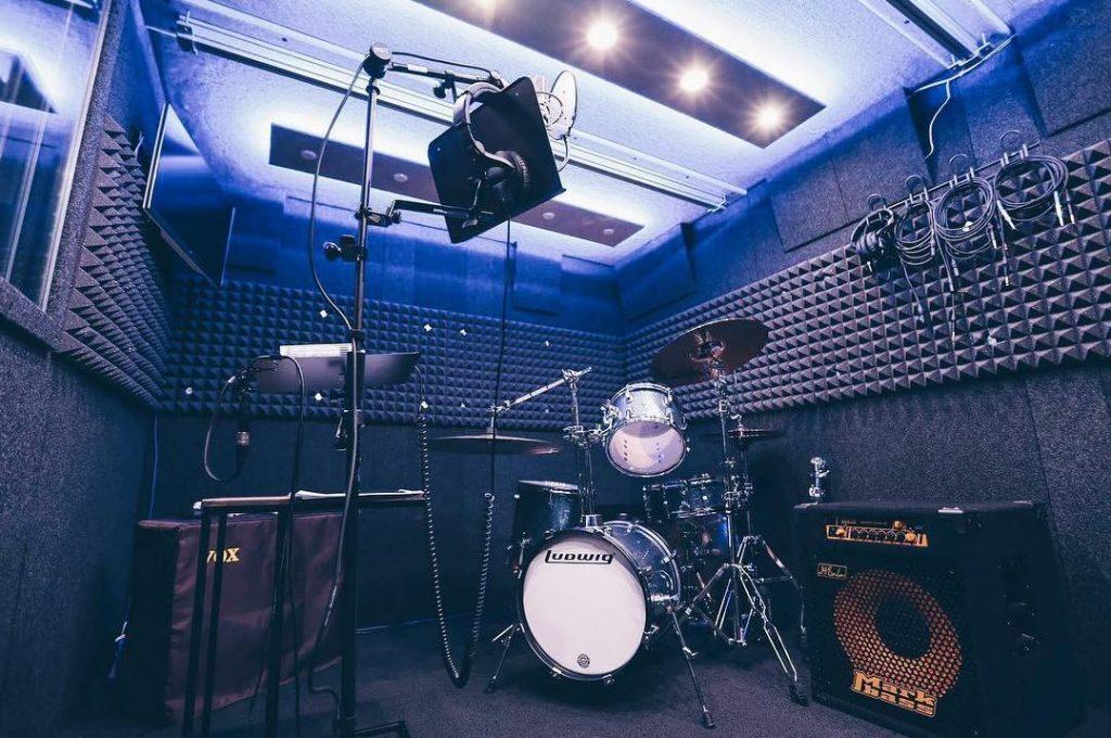image of multiple instruments setup inside a whisperroom drum booth