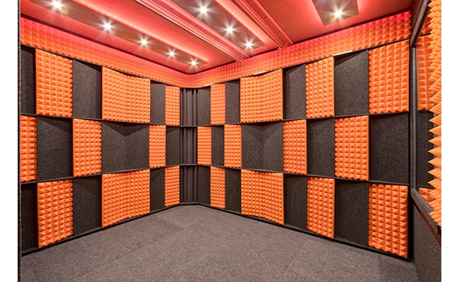 he Acoustic Tuning Package by WhisperRoom with alternating orange studio foam