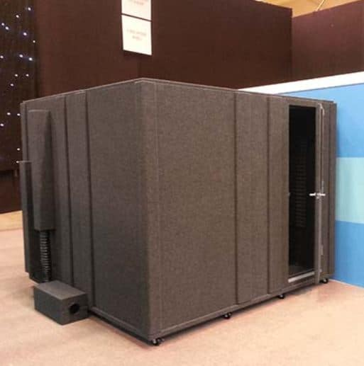 A 8.5'x8.5' WhisperRoom booth in an open floor recording studio