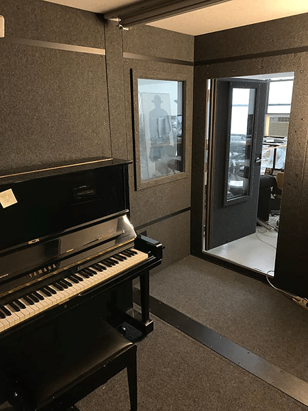 An inside look at a 8.5'x10.5' WhisperRoom practice booth equipped with a piano