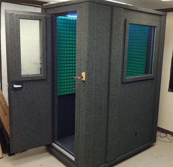 Side image of a 3.5'x5' WhisperRoom booth with green acoustic foam and a wall window