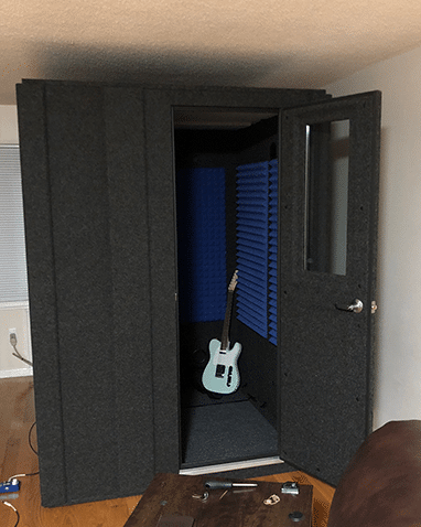 image of whisperroom and guitar set up in a living room