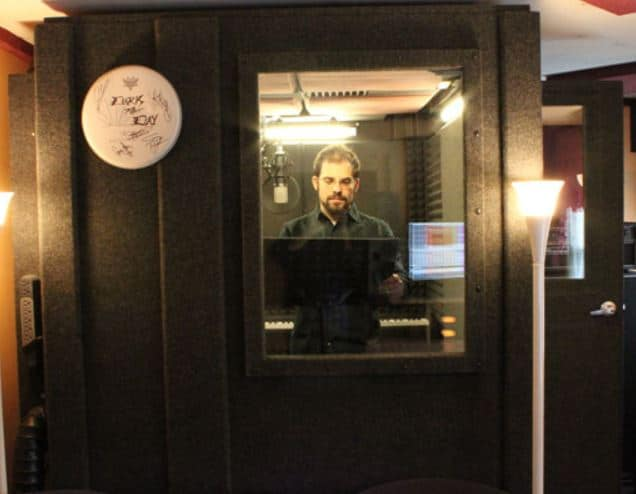 image of a whisperroom booth with a man you can see through the window