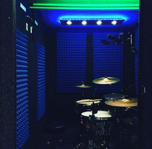 image of a drum kit inside of a whisperroom drum booth