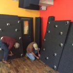 Two men building a WhisperRoom inside of Syracuse Coworks