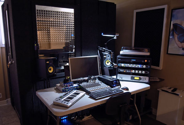 One of WhisperRoom's recording booths with audio racks and recording equipment