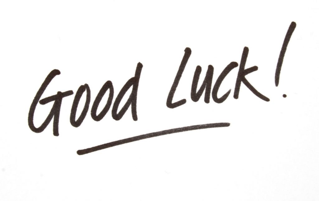 "The phrase ""good luck"" handwritten with a marker"