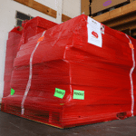 image of a WhisperRoom shrink wrapped on a pallet