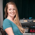 Mastering Engineer Kim Rosen sitting at her audio workstation