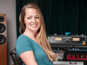 Mastering Engineer Kim Rosen sitting at her audio workstation