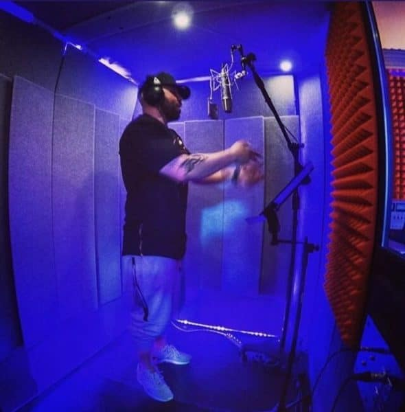 A man performing vocals inside of a WhisperRoom vocal booth