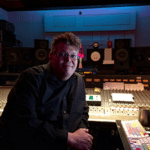 Mastering Engineer Harold LaRue next to his pro audio workstation inside of a recording studio
