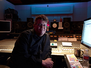 Mastering Engineer Harold LaRue next to his pro audio workstation inside of a recording studio