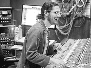 Nashville Mixing Engineer Justin Francis standing at a mixing console in a std