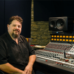 Steve Chadie sitting next to his mixing console