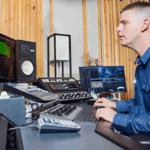 Matty Harris producing music at his console