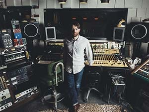 Chief Engineer M Allen Parker Standing next to his recording console