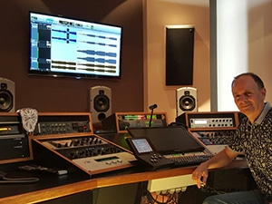 Andres Mayo sitting inside of his recording studio
