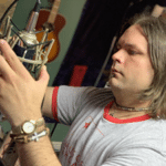 Recording Engineer Grant Walden positions a microphone