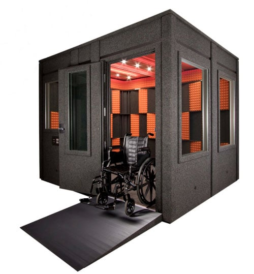 An ADA compliant WhisperRoom with a wheelchair ramp attached