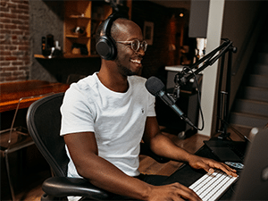 Man recording a podcast in his home studio