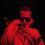 Miles Davis plugging his ears while holding a trumpet