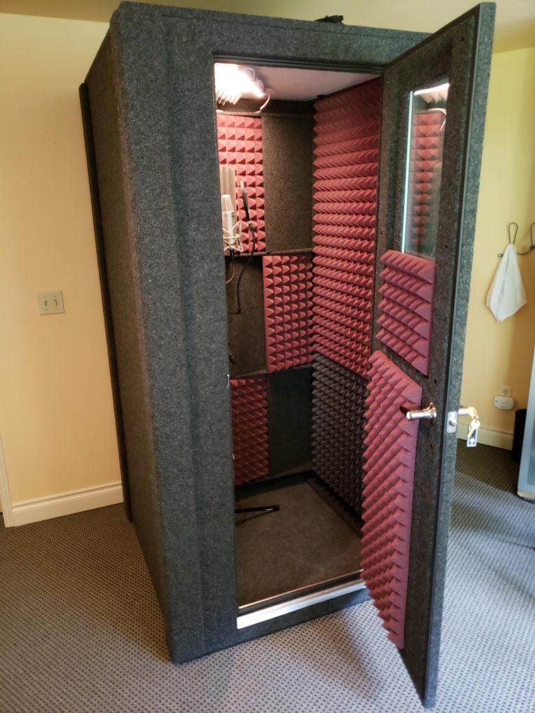 A WhisperRoom with door open to show off the studio foam
