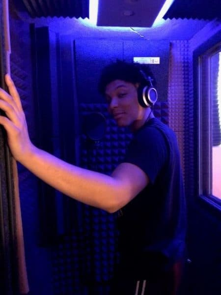 Young man in his booth wearing headphones