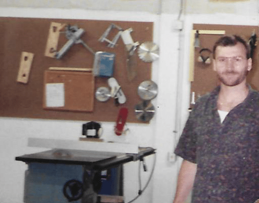 Founder and president of WhisperRoom standing in the company's wood shop