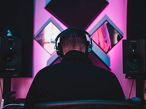 A music producer sitting at his workstation