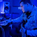 A man recording in his home studio