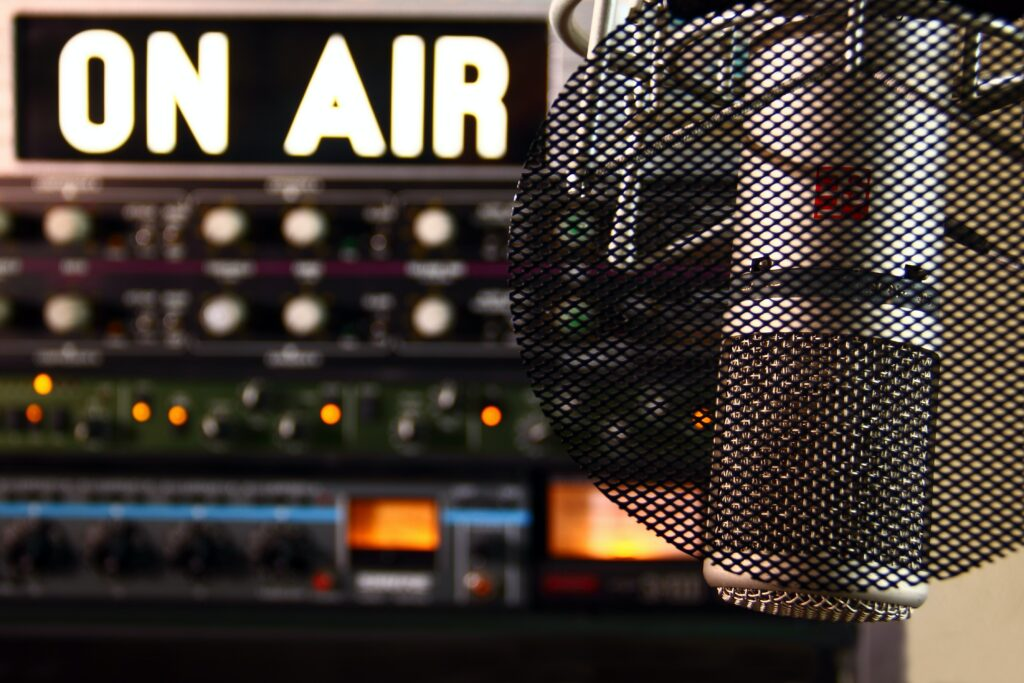 """An """"on-air"""" sign next to a microphone"""