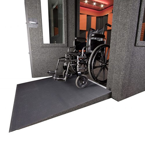 image of a wheelchair and a wheelchair ramp set up with a recording booth