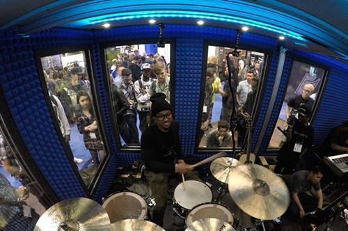 image of a drummer inside of a whisperroom drum booth at the NAMM Show