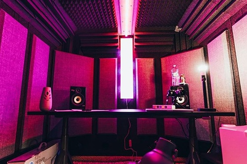 The interior of a WhisperRoom recording booth with acoustic sound panels on the wall.