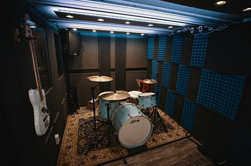 A drumkit inside of a WhisperRoom rehearsal booth