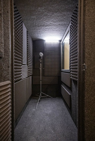 The interior of a WhisperRoom vocal booth with gray acoustic foam on all the walls.