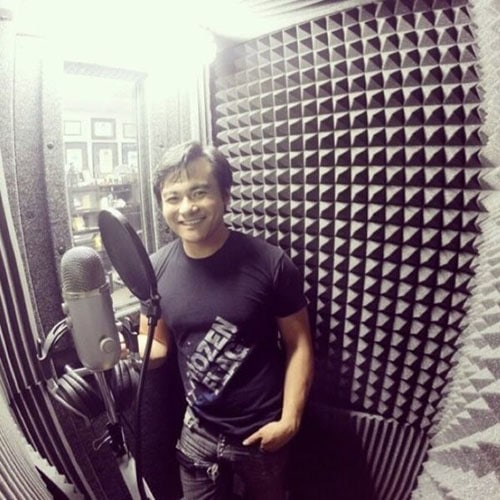 A man recording voice overs into a microphone in his WhisperRoom