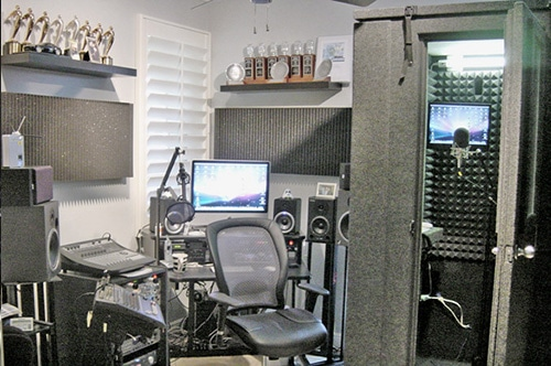 A home studio that is full of trophies, studio gear, and equipment to record voice-overs