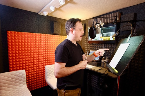 A man recording voice over inside his WhisperRoom