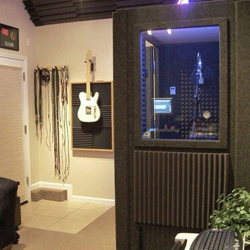 A WhisperRoom vocal booth inside of a home studio