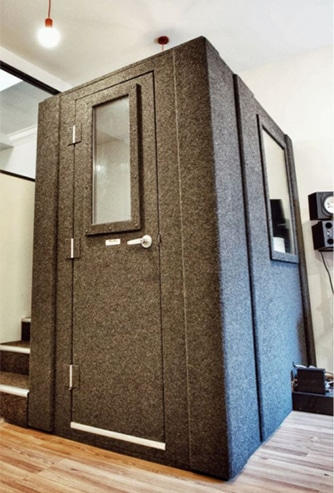 A WhisperRoom office phone booth inside of an open floor office.
